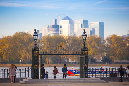canary wharf: LONDON, UK - OCTOBER 31, 2015: Panorama Panorama of Canary Wharf. View from park, includes River Thames and walking people Editorial