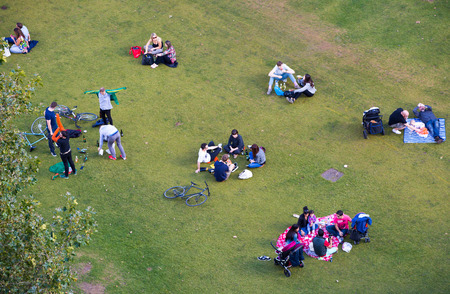 listed buildings: LONDON UK - SEPTEMBER 19, 2015:  People resting at grass Editorial