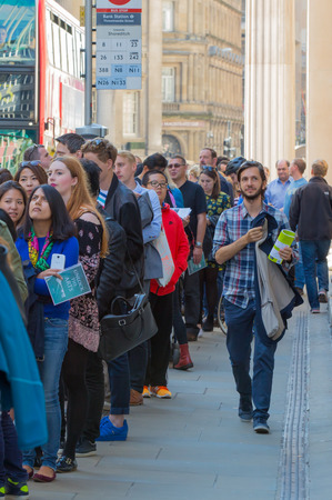 line people: LONDON UK - SEPTEMBER 19, 2015: Queue on the Bank street. People waiting to see Bank of England in open day event