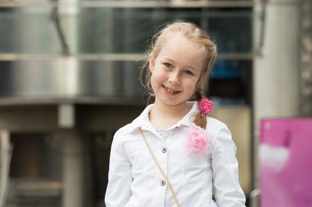 haste: Little girl portrait in the city Stock Photo