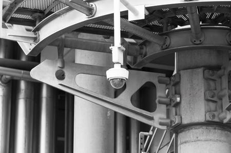lloyds: LONDON UK - SEPTEMBER 19, 2015 - Security camera. Lloyds of London bank building, famous texture. City of London