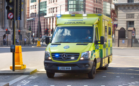 uk: LONDON UK - SEPTEMBER 19, 2015: Ambulance car on the Bank street Editorial