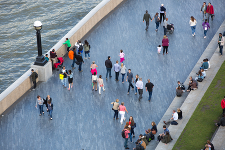 river thames: LONDON UK - SEPTEMBER 19, 2015 - Lots of people walking by river Thames. City of London in weekend
