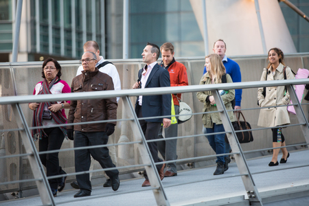 many people: LONDON, UK - 7 SEPTEMBER, 2015: Canary Wharf business life. Business people going home after working day.