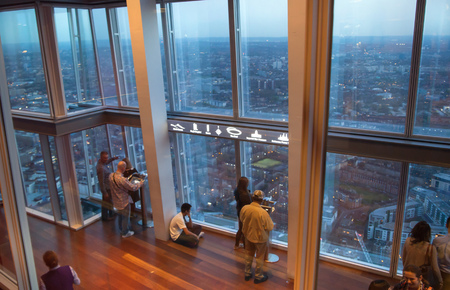 april 15: LONDON, UK - APRIL 15, 2015: People admiring sunset view in London Editorial