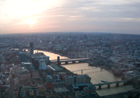 april 15: LONDON, UK - APRIL 15, 2015: City of London business and financial aria view at sunset Editorial