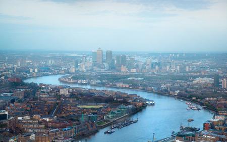 april 15: LONDON, UK - APRIL 15, 2015: City of London panorama at sunset.  Canary Wharf
