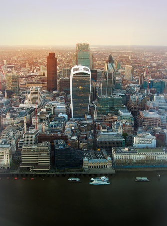 sunset city: LONDON, UK - APRIL 15, 2015: City of London business and financial aria view at sunset Editorial