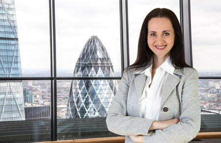 businesswoman suit: Beautiful business woman portrait in Londons office Stock Photo