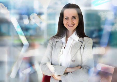 businesswoman suit: Beautiful business woman portrait walking in office against of glass reflection Stock Photo