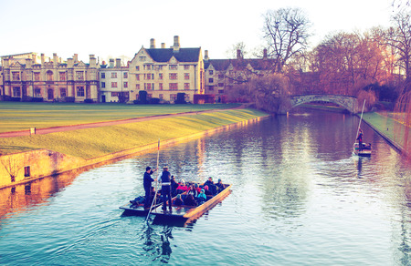 CAMBRIDGE, UK - JANUARY 18, 2015: River Cam and tourists boats