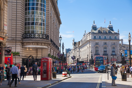 piccadilly: LONDON, UK - MAY 14, 2015: People and traffic in Piccadilly Circus in London. Famous place for romantic dates.Square was built in 1819 to join of Regent Street Editorial
