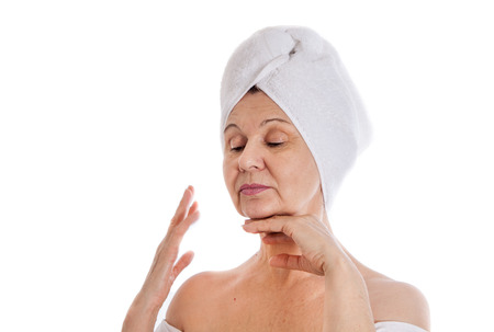 good looking woman: Spa concept. Aged good looking woman with white towel on her head