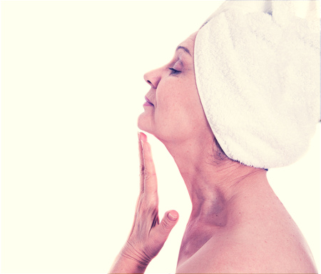 gente saludable: Spa concept. Aged good looking woman with white towel on her head