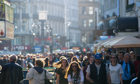 street people: LONDON, UK - SEPTEMBER 10, 2015: Lots of people walking on the street city centre Editorial