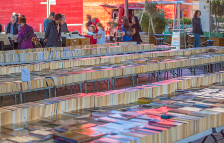 secondhand: LONDON, UK - SEPTEMBER 10, 2015:  People browsing secondhand books at the Southbank Centre Book Market in London, England. Editorial
