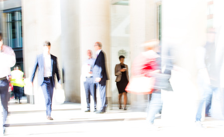 people office: LONDON UK - SEPTEMBER 10, 2015: City of London lunch time. Lots of office people walking on the street. People blur