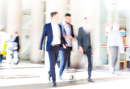 going: LONDON UK - SEPTEMBER 10, 2015: City of London lunch time. Lots of office people walking on the street. People blur