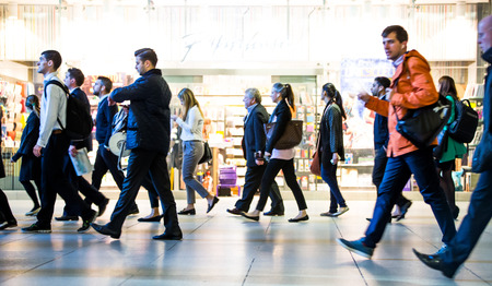 commuters: LONDON, UK - SEPTEMBER 14, 2015: Lots of people going to work. Early morning hours in Canary Wharf, modern business life concept