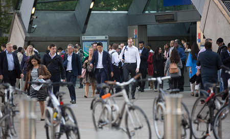 going: LONDON, UK - SEPTEMBER 14, 2015: Lots of people going to work. Early morning hours in Canary Wharf, modern business life concept