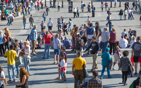 hot day: LONDON, UK - SEPTEMBER 10, 2015: Lots of people and tourists on the Trafalgar square in hot summer day Editorial