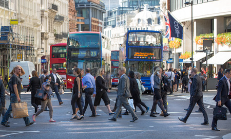 lots people: LONDON, UK - SEPTEMBER 10, 2015: City of London buddy street and lots of people crossing the road. Lunch time