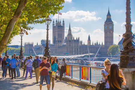 british weather: LONDON, UK - SEPTEMBER 10, 2015: Big Ben and Houses of Parliament. View from the River Thames embankment