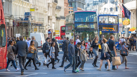 street people: LONDON UK - SEPTEMBER 10, 2015: Office workers, business people walking on the City street next to st. Paul cathedral