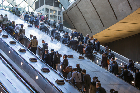lots people: LONDON, UK - SEPTEMBER 14, 2015: Lots of people going up to escalator in Canary Wharf, modern business life concept