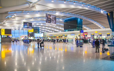 terminals: LONDON, UK - MARCH 28, 2015: Interior of departure hall Heathrow airport Terminal 5. New building
