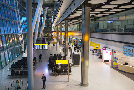 lots people: LONDON, UK - MARCH 28, 2015: Interior of arrival hall of Heathrow airport Terminal 5. Lots of people waiting for arrivals Editorial
