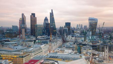 sunset city: LONDON, UK - JANUARY 27, 2015: panoramic view City of London at sunset