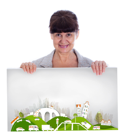 green city: Good looking woman holding City background made of white paper stickers with space for your text
