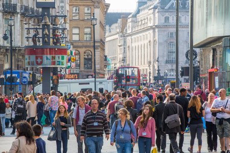 uk: LONDON, UK - OCTOBER 4, 2016: Crowd of people crossing the road on the Regent street. Tourists, shoppers and business people rush time