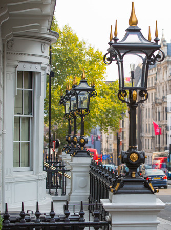 old houses: LONDON, UK - OCTOBER 4, 2016: Pall Mall street view with luxury houses entrances decorated with classic lantern