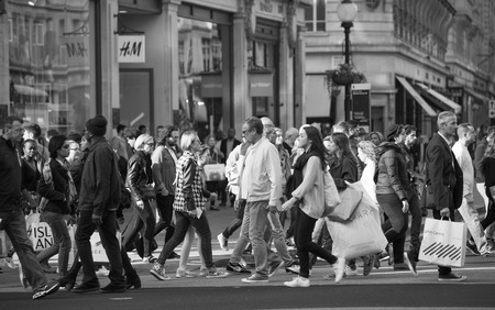 crossing street: LONDON, UK - OCTOBER 4, 2016: Crowd of people crossing the road on the Regent street. Tourists, shoppers and business people rush time