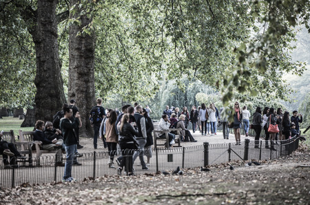 park path: LONDON, UK - OCTOBER 4, 2016: Sant James park path with lots of walking people