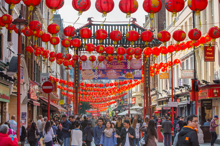 chinese new year food: LONDON, UK - OCTOBER 4, 2016: China Town is decorated by Chinese lanterns and lots of tourists and Londoners walking on the street. ChinaTown was established in 1880 by Chinese sailors and traders
