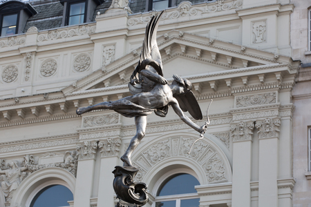 angels fountain: Eros Statue at Piccadilly Circus, London, UK Editorial