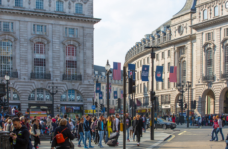 britain: LONDON, UK - OCTOBER 4, 2016:  Regent street view with transport and walking people Editorial