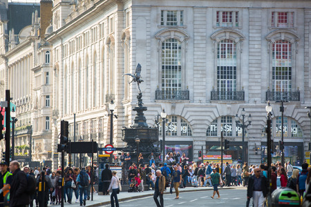 old street: LONDON, UK - OCTOBER 4, 2016:  Piccadilly street view with transport and walking people Editorial