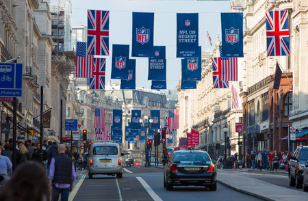 regent: LONDON, UK - OCTOBER 4, 2016:  Regent street view with transport and walking people Editorial
