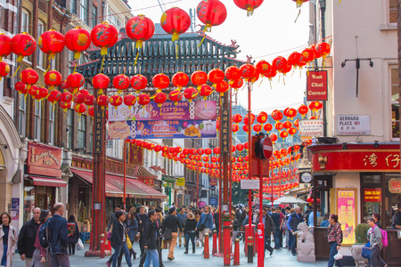 chinatown: LONDON, UK - OCTOBER 4, 2016: China Town is decorated by Chinese lanterns and lots of tourists and Londoners walking on the street. ChinaTown was established in 1880 by Chinese sailors and traders