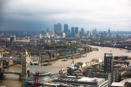 canary wharf: LONDON, UK - SEPTEMBER 17, 2015: London panorama with River Thames, Tower bridge and Canary Wharf at the distance