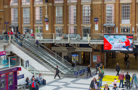 arrival: LONDON, UK - SEPTEMBER 12, 2015: Liverpool street train station with lots of people, waiting for boarding, looking for information and walking through the hall