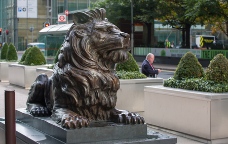 office entrance: LONDON, UK - SEPTEMBER 14, 2015: Lion sculpture in front of office entrance in Canary Wharf Editorial