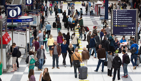 construction platform: LONDON, UK - SEPTEMBER 12, 2015: Liverpool street train station with lots of people, waiting for boarding, looking for information and walking through the hall