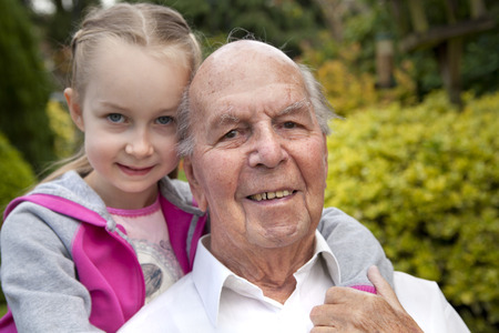 granny and grandad: 95 years old english man with granddaughter in garden