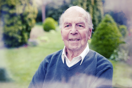 old english: Portrait of 95 years old english man in his garden