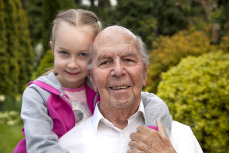 old english: 95 years old english man with granddaughter in garden